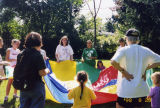 Student volunteers and children at Independence First Picnic, 1998