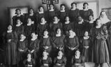 Crow girls and Ursuline nun in classroom, 1911? - 1925?